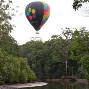 Floating above a local river on your Byron Bay Hot air Balloon Flight on the Far North Coast of NSW