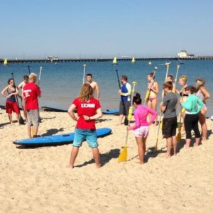 Beginning your Stand Up Paddle Board lesson at St Kilda