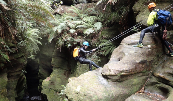 Abseiling into a canyon in the Blue Mountains.