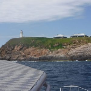 The lighthouse and dwellings on the Solitary Islands Boat Cruise Coffs Harbour